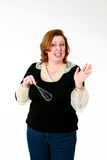 Funny woman with whisk Stock Image
