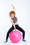 Funny woman workout with fitness ball Royalty Free Stock Photo