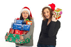 Funny women with Christmas gifts Stock Photos
