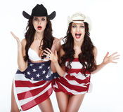 Funny Women in Hats Wrapped in USA Flag Stock Photos