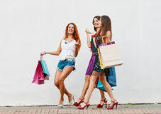 Funny Women with Shopping Bags Royalty Free Stock Photography