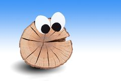 Funny wooden face with gradient background. Funny wooden face with big eyes on gradient background white and blue stock image