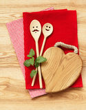 Funny wooden spoons on tablecloth Royalty Free Stock Photography