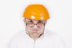 Funny worker in helmet with emotion on her face on white backgro Stock Image
