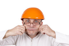 Funny worker in helmet with emotion on her face on white Stock Image