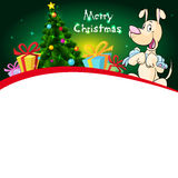 Funny xmas design with christmas tree and dog hold doll Royalty Free Stock Photography