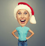 Funny xmas girl in red hat Royalty Free Stock Images