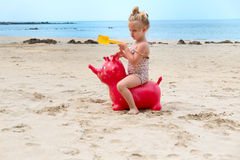 Funny 3 years old girl playing at the bech Stock Photo