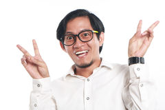 Funny Young Asian Businessman Looked Very Happy. Photo image portrait of a funny young Asian businessman wearing glasses looked very happy, close up portrait Stock Photos