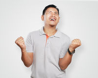 Funny Young Asian Guy Celebrating Victory Royalty Free Stock Photo