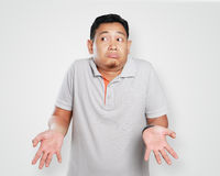 Funny Young Asian Guy Shrug Gesture stock image
