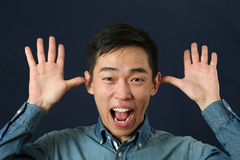 Funny young Asian man making face Royalty Free Stock Images