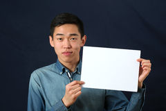 Funny young Asian man showing copy space page Royalty Free Stock Images