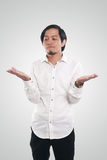 Funny Young Asian Man Showing His Open Palm Royalty Free Stock Image