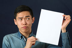Funny young Asian man showing white copy space page Stock Image