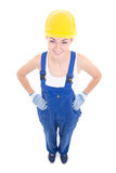 Funny young attractive woman builder in workwear isolated on whi Stock Photography