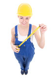 Funny young attractive woman builder in workwear with measure ta Stock Images