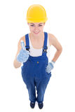 Funny young attractive woman builder in workwear thumbs up isola Royalty Free Stock Photos