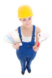Funny young attractive woman painter in workwear with colorful p Stock Photo