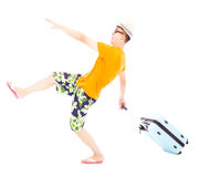 Funny young backpacker pulling a baggage to travel worldwide. In studio Stock Photography