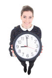 Funny young beautiful business woman showing clock isolated on w Royalty Free Stock Image
