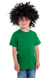 Funny Young Boy Wearing a big Black Wig. Young smiling boy in studio on white background with a big black funny wig Royalty Free Stock Photos