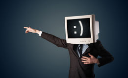 Funny young businessman with a monitor on his head and smiley on Stock Images