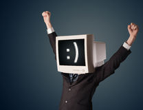 Funny young businessman with a monitor on his head and smiley on Royalty Free Stock Image