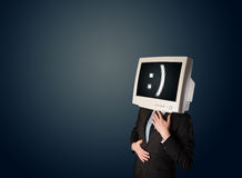 Funny young businessman with a monitor on his head and smiley on Stock Photography