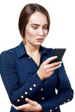 Funny young businesswoman. SMS. Funny young businesswoman reading bad news text message. Beautiful young caucasian woman isolated on white background holding her Stock Photos