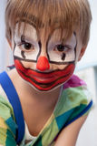Funny young clown. Close-up portrait of little smiling 5-years old boy dressed as a clown Royalty Free Stock Photo