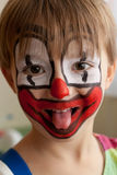 Funny young clown. Close-up portrait of little smiling 5-years old boy dressed as a clown Royalty Free Stock Images