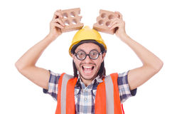 Funny young construction worker with broken brick Royalty Free Stock Photo