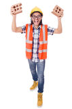 Funny young construction worker with broken brick Stock Images