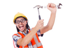 Funny young construction worker with hammer and Royalty Free Stock Image