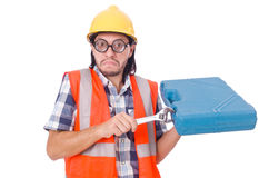 Funny young construction worker with toolbox and Royalty Free Stock Image