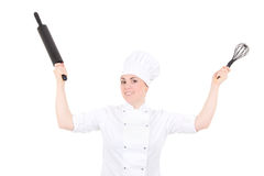 Funny young cook woman in uniform with baking rolling pin isolat Stock Image
