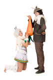 Funny young couple with carrot Royalty Free Stock Photography