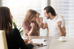 Funny young couple enjoying buying own apartment, we did it. Funny couple excited by purchasing real estate meeting with agent to get the keys, delighted young Royalty Free Stock Images