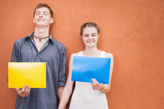 Funny young couple looking at camera and holding frames background Royalty Free Stock Photography