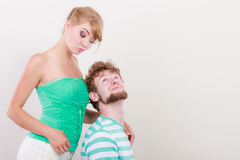 Funny young couple making silly face. Funny playful young couple making silly face blonde girl and bearded guy studio shot Stock Photos