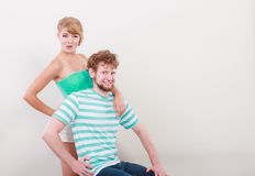 Funny young couple making silly face. Funny playful young couple making silly face blonde girl and bearded guy studio shot Stock Photo