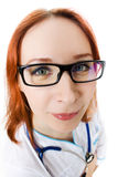 Funny young female doctor. On white background Stock Image