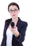 Funny young female journalist with microphone isolated on white. Background Stock Photo