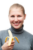 Funny young girl with a banana Royalty Free Stock Photo