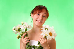 Funny young girl with chamomile flowers Stock Photos