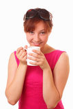 Funny young girl with a cup of tea Royalty Free Stock Photo