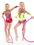 Funny young girl gymnasts show exercise. Stock Image