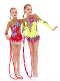 Funny young girl gymnasts show exercise. Stock Images