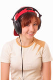 Funny young girl litening to music with headphones Stock Photos